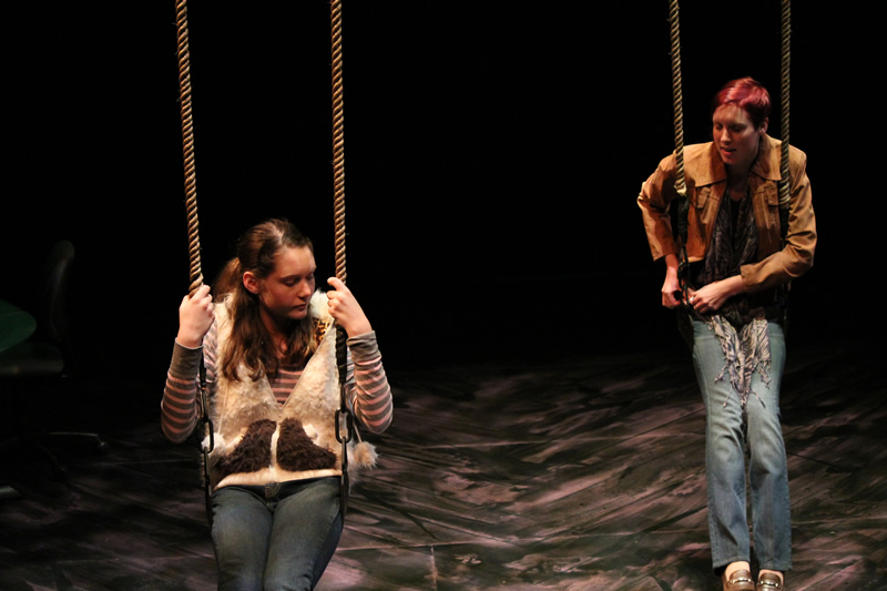 Lehigh University Theatre - Two people sitting on swings