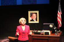 Lehigh University Theatre - Dusty and the Big Bad World, woman in pink in front of desk